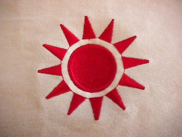 http://www.ludism.org/piecepack/trophy-cloth/03_embroidery.jpg